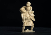 Netsuke Ivory, man with monkey, Japan, signed Meiji