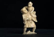Netsuke Ivory, man with monkey, Japan, signed Meiji